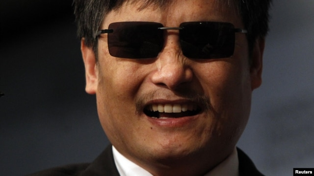 Blind activist Chen Guangcheng smiles during an appearance at the Council on Foreign Relations in New York City, May 31, 2012.
