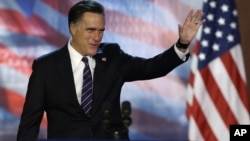 Republican presidential candidate Mitt Romney waves to supporters before conceding at his election night rally, November 7, 2012, in Boston, Massachusetts.