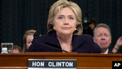 Democratic presidential candidate, former Secretary of State Hillary Rodham Clinton takes her seat on Capitol Hill in Washington, Oct. 22, 2015, prior to testifying before the House Benghazi Committee.
