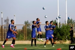 Iran's national men's football team takes part in a training session a day before their Group A match against Syria during the 2018 FIFA World Cup Russia Qualifier, in Tehran, Iran, Sept. 4, 2017.