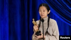 Chloe Zhao accepts one of her awards Sunday night. (Reuters)