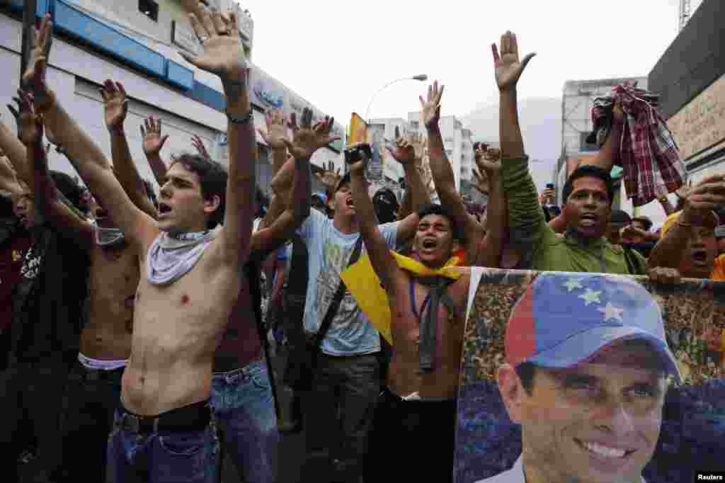 Supporters of opposition leader Henrique Capriles block a street while demonstrating for a recount of the votes in Sunday's election.