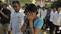 An unidentified relative of one of the convicted Hindus breaks down upon hearing the verdict at the district court in Mehsana, about 40 kilometers (25 miles) north of Ahmadabad, India, November 9, 2011.