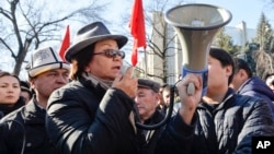 FILE - Kyrgyzstan's former president, Roza Otunbayeva, attends a rally in support of opposition leader Omurbek Tekebayev, after his arrest, in Bishkek, Kyrgyzstan, Feb. 26, 2017.