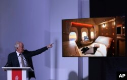 Emirates Airline President Tim Clark shows off new, state-of-the-art, first class private suites, during a press conference at the opening day of the Dubai Air Show, United Arab Emirates, Nov. 12, 2017.
