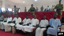 Suspected members of Boko Haram sit in court in N'Djamena, Nigeria, Aug. 26, 2015.