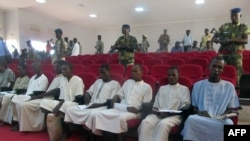 A picture taken Aug. 26, 2015 shows suspected members of Boko Haram sitting in court in N'Djamena.