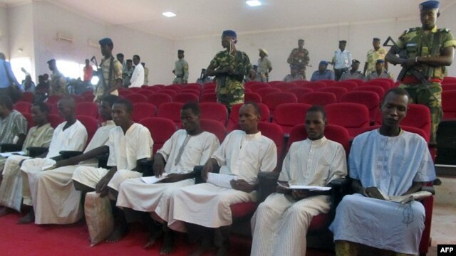 Suspected members of Boko Haram sit in court in N'Djamena, Nigeria, Aug. 26, 2015.