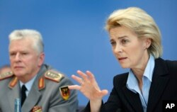 FILE - German Defense Minister Ursula von der Leyen, right, and Volker Wieker, Inspector General of the German armed forces, address the media during a joint press conference in Berlin, Germany, Dec. 3, 2015.