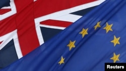 The EU and British flags fly outside the European Commission Representation in central London, Jan. 23, 2013.