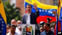 Juan Guaido, head of Venezuela's opposition-run congress, declared himself interim president until new elections can be called in Caracas, Venezuela, Wednesday, Jan. 23, 2019. (AP Photo/Fernando Llano)