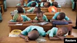 FILE - Muslim boys rest their heads on their desks during a language class at Al-Haramain madrassa at the Islamic Complex in Cameroon's capital Yaounde. Teachers, especially in the north, are afraid to return to their classrooms because of Boko Haram.