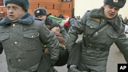 Russian police detain a participant during an opposition rally in Moscow, March 17, 2012.