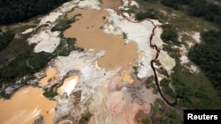 An aerial view of the environmental damage caused by illegal mining at the Canaima National Park in southern Bolivar State on June 17, 2010.