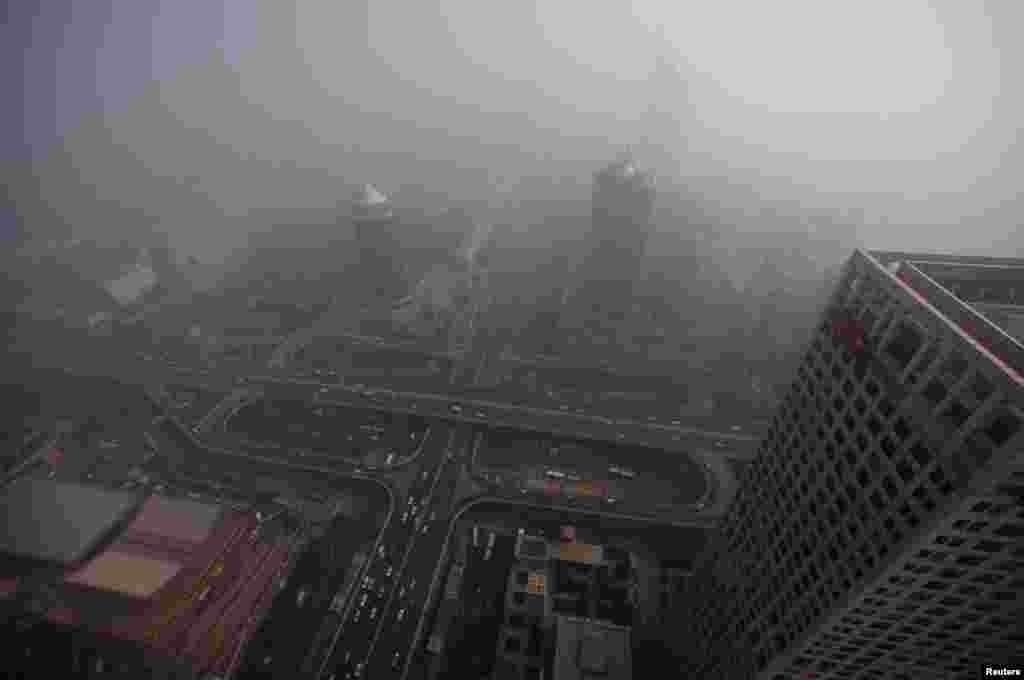 Buildings and the Guomao Bridge are pictured amid heavy haze and smog in Beijing, October 29, 2011.