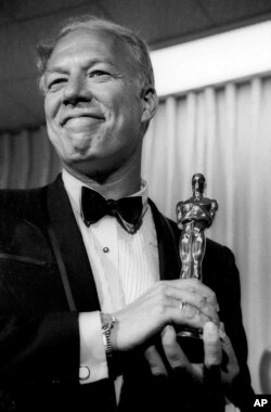 """FILE - George Kennedy poses with his Oscar in Santa Monica, California, after winning best supporting actor for """"Cool Hand Luke,"""" April 10, 1968."""
