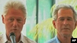 Former presidents Bill Clinton and George Bush speak at donor's conference for Haiti reconstruction aid. (file)