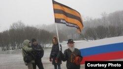 Участник движения НОД в акции за передачу Исаакия РПЦ