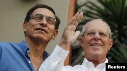 FILE - Peru's Vice President Martin Vizcarra, left, and President Pedro Pablo Kuczynski greet the media in Lima, Peru, March 16, 2016.
