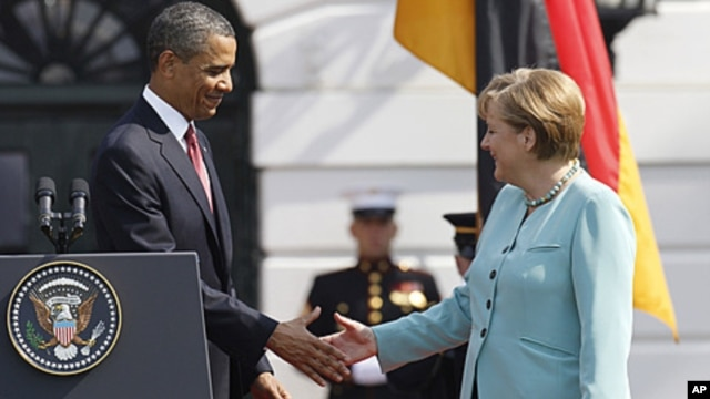 President Barack Obama shakes hands with German Chancellor Angela Merkel on the South Lawn at the White House in Washington, June 7, 2011.