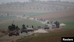 FILE - Members of al Qaida's Nusra Front drive in a convoy as they tour villages, which they said they have seized control of from Syrian rebel factions, Dec. 2, 2014.