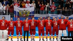 The Russian team sings their national anthem while wearing their gold medals.