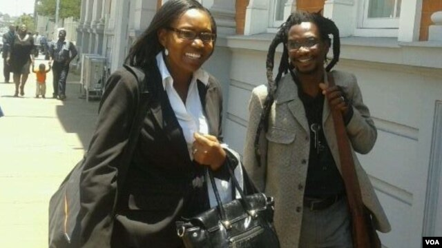 Artist Owen Maseko and lawyer Nosimilo Chanayiwa leaving the Constitutional Court. Maseko was once arrested for displaying Five Brigade artworks in Bulawayo. (Photo/Iwrin Chifera)