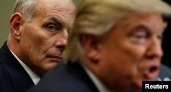 Homeland Security Secretary John Kelly listens to U.S. President Donald Trump during a meeting with cyber security experts in the Roosevelt Room of the White House, Jan. 31, 2017.