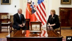 U.S. Vice President Mike Pence chats with Chile's President Michelle Bachelet in Santiago, Chile, Aug. 16, 2017.