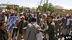 Sledbenici jemenskog predsednika tokom sukoba sa anti-vladinim demonstrantima, Sana, 14. februar, 2011.