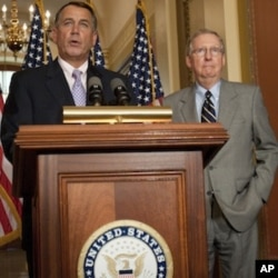 US Speaker of the House John Boehner (L) and US Senate Minority Leader Mitch McConnell hold a press conference on July 30, 2011 at the US Capitol in Washington, DC.