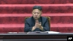 North Korean leader Kim Jong Un claps hands during the Supreme People's Assembly's second meeting of the year, in Pyongyang, North Korea, September 25, 2012..