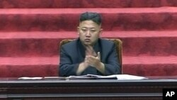 FILE - North Korean leader Kim Jong Un claps hands during the Supreme People's Assembly's second meeting of the year, in Pyongyang, North Korea, Sept. 25, 2012.