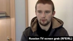 Russian television shows Vitaliy Kryvosheyev, who identifies himself as the head of a nationalist group called the Ukrainian National Union, and claims he was taking his instructions directly from Ukraine's Security Service.