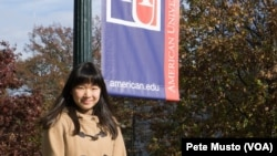 International student Marine Hayashi, from Japan, stands on the campus of American University