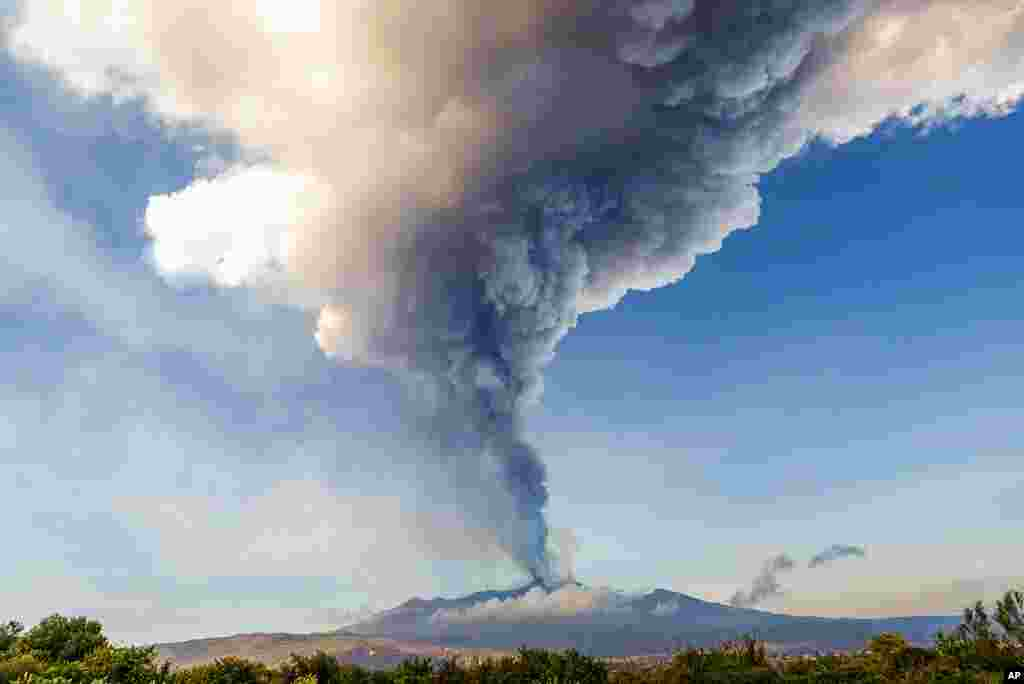 Smoke billows from the Mt. Etna volcano as seen from Giarre, Sicily.