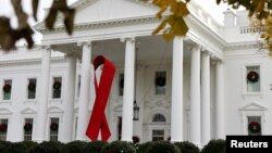 A red ribbon memorializes World AIDS Day on the North Portico of the White House