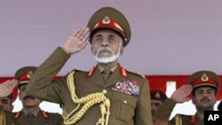 Oman's Sultan Qaboos bin Said salutes as he attends a military parade in Muscat to mark the Gulf sultanate's 40th National Day, 18 Nov 2010