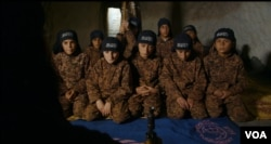 Osama, 13, wears an al-Nusra Front uniform in a camp training youth to fight for the terror group. (Kahtan Hasson for VOA)