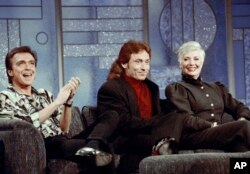 FILE - In this July 13, 1993, file photo, former Partridge Family cast members David Cassidy, from left, Danny Bonaduce and Shirley Jones reunite on the Arsenio Hall Show, Los Angeles, Calif. This was the first time the three had appeared together since t