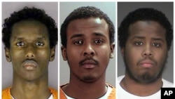 A combination picture shows, left to right, defendants Guled Ali Omar, Abdirahman Daud and Mohamed Farah. Of the nine men found guilty, Omar received the longest sentence, 35 years, with Daud and Farah getting 30 years each. The remaining six men received shorter sentences, with one being released for time served.