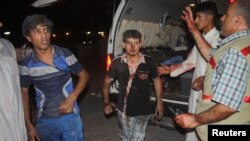 Men wounded by car bomb attack, Nasiriyah city, Iraq, Aug. 10, 2013.
