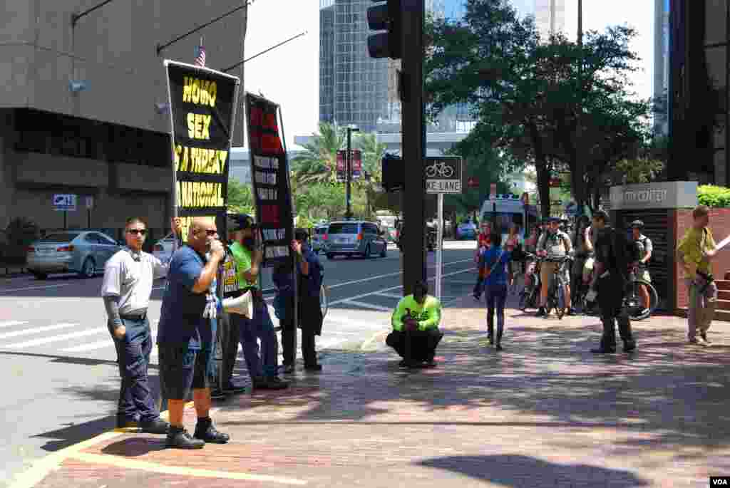 A group protesting the Mormon church outside the Republican National Convention, Tampa, Florida, August 28, 2012. (J. Featherly/VOA)