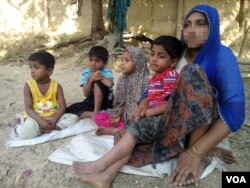 To escape violence in Rakhine state during the military crackdown there, in November 2016, Rohingya woman Haresa Begum fled to Bangladesh with her four children, leaving her husband in Myanmar. A week after this photo was taken at a Rohingya colony in Cox