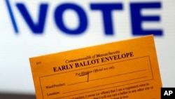 Campaign 2016 Early Voting: In this Oct. 24, 2016, photo, an early ballot envelope is held at town hall in North Andover, Mass. The millions of votes that have been cast already in the U.S. presidential election point to an advantage for Hillary Clinton i