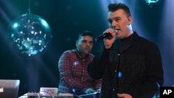 FILE - Naughty Boy and Sam Smith record 'La La La' for BBC 1's Christmas Day Special in London on Dec. 7, 2013.