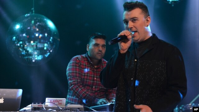 FILE - Naughty Boy and Sam Smith record 'La La La'  for BBC 1's Christmas Day Special in London on Dec. 7, 2013.