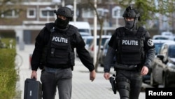 Police officers are seen after a shooting in Utrecht, Netherlands, March 18, 2019.