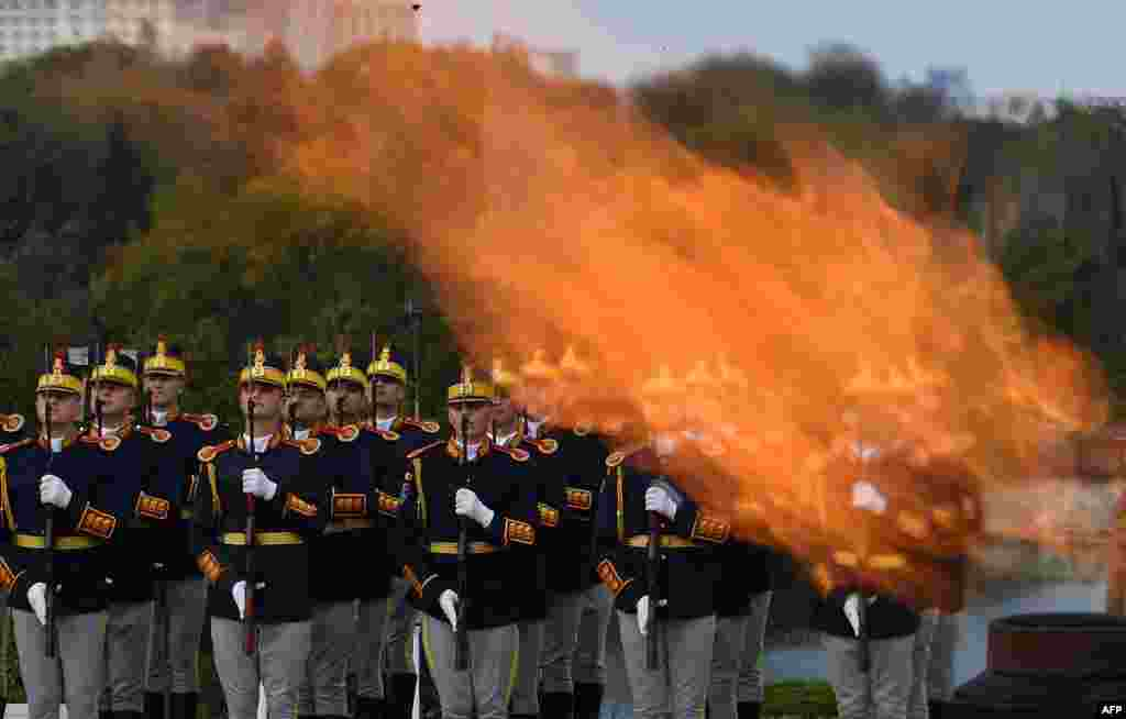 Members of the Romanian military take part in a celebration of the Romanian Army Force's Day, next to the Monument of Unknown Soldier, at Carol Park in Bucharest.
