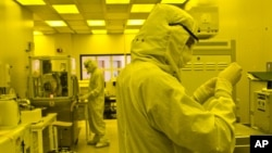 Researchers work in a clean room at the expanded University of Michigan Lurie Nanofabrication Facility in Ann Arbor, Michigan, April 10, 2008.